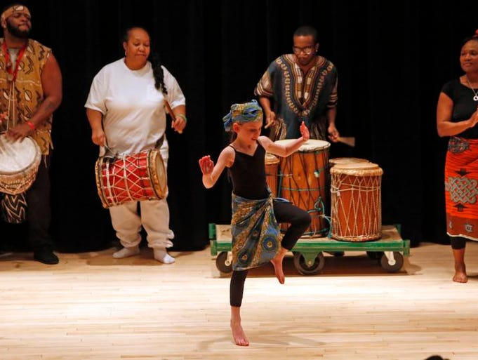 Ann Gombiner, 8, of New Rochelle performs with members of the Bokandeye African Dance and Drum Troupe in celebration of Black History, Feb. 22, 2014 at the New Rochelle library. Gombiner was one of the students that participated in the seven-week African Dance and Drum Workshops at the library, led by Anthony Wooden and his troupe.