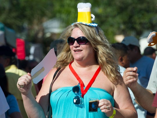 Cat Miller, of Fort Pierce, samples a beer while checking