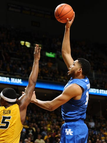 Karl-Anthony Towns goes for a shot over D'Angelo Allen.