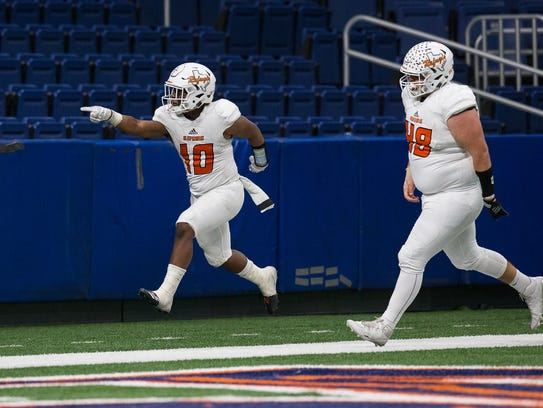 Refugio's Jacobe Avery celibates after scoring a touchdown