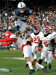 Saquon Barkley, playing for Penn State, hurdles Rutgers' Kiy Hester (2) during the second half of an NCAA college football game in State College, Pennsylvania on Nov. 11, 2017.