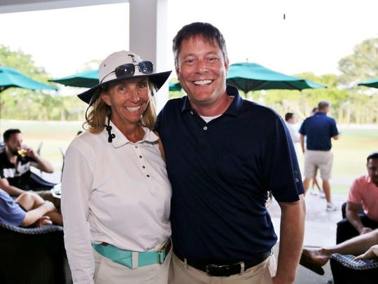 Mari Frankel, board member, and Matt Constantine, CEO of Adopt-A-Family of the Palm Beaches.