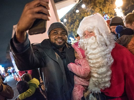 Bet Akpabali and 17-month-old daughter Adalyn take a selfie with Santa.