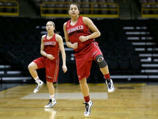 Louisville's Shoni Schimmel, right, and Jude Schimmel, left, stretch during practice at the NCAA women's college basketball tournament, Saturday, March 22, 2014, in Iowa City, Iowa. Louisville plays Idaho in a first-round game on Sunday. (AP Photo/Charlie Neibergall)
