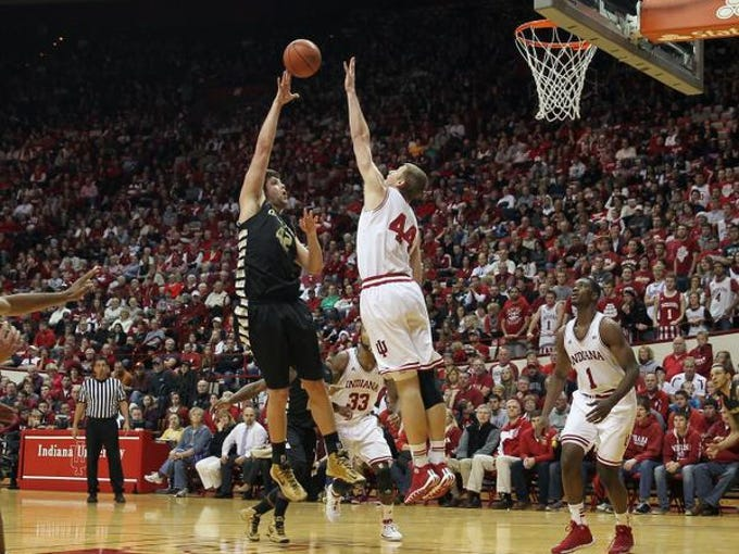 Dec 10, 2013; Bloomington, IN, USA; Oakland Golden Grizzlies forward/center Corey Petros (42) shoots over Indiana Hoosiers center Luke Fischer (44) during the second half at Assembly Hall. Indiana won 81-54. Mandatory Credit: Pat Lovell-USA TODAY Sports