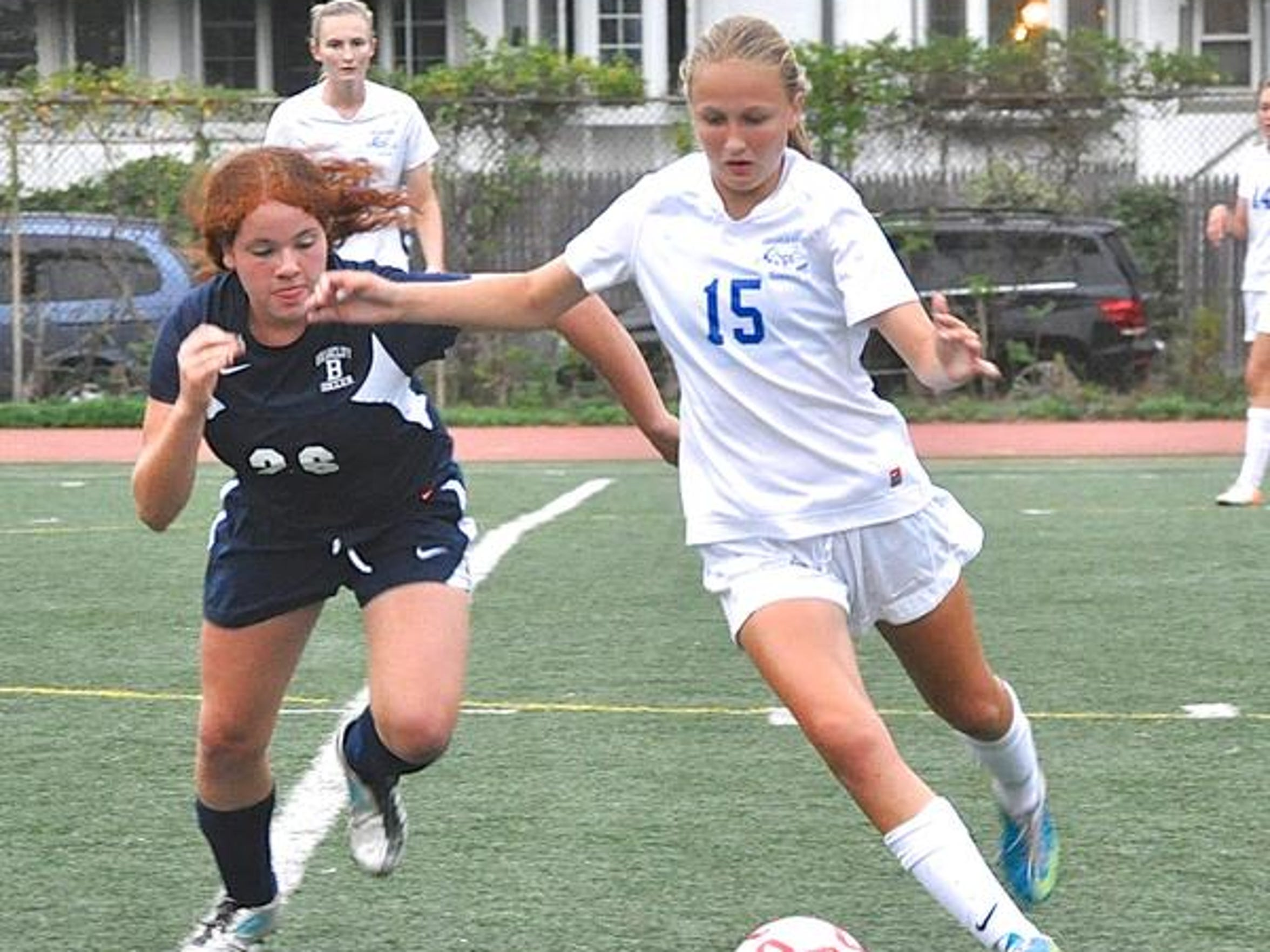 Briarcliff's Elizabeth Kreppel (left) defends against