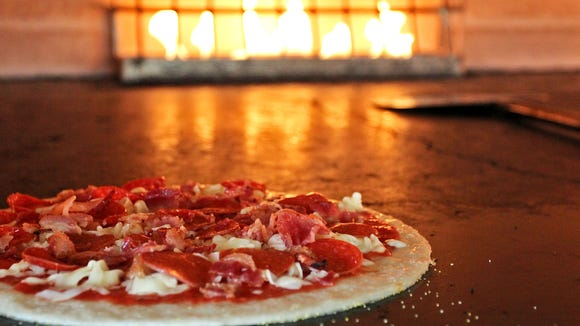 Pizzas at Pieology are cooked or three minutes in a stone oven.