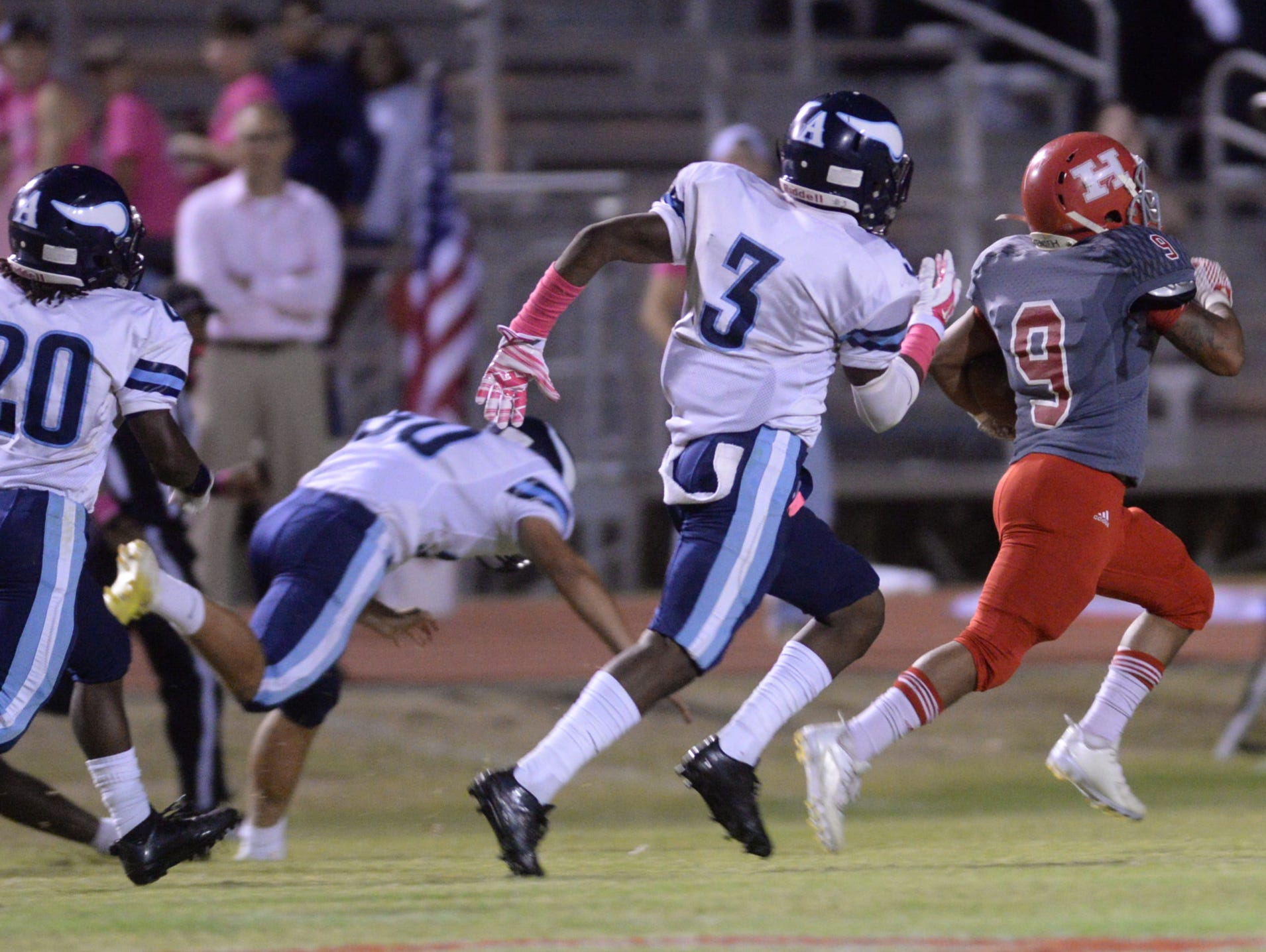 Haughton's Keiuntre Normandin is trailed by a swarm of Airline defenders to be stopped just shy of the end zone.