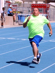 Team Carlsbad's Eric Jacquez heads for the finish line