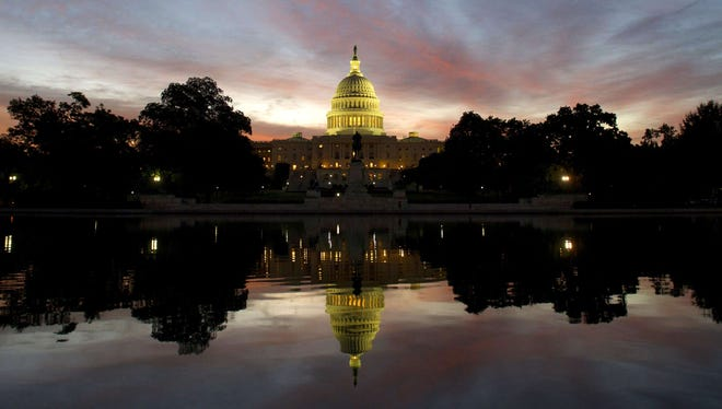 The U.S. Capitol dome is seen at sunrise over Washington, D.C., September 25, 2013.