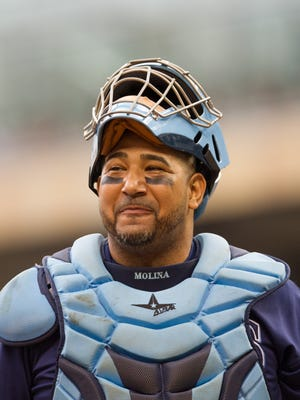 Jose Molina finalized a two-year deal to stay with the Rays.