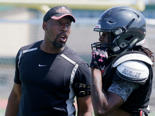 Tarig Holman (left), Neptune's new head coach, instructs his team during a practice last month.