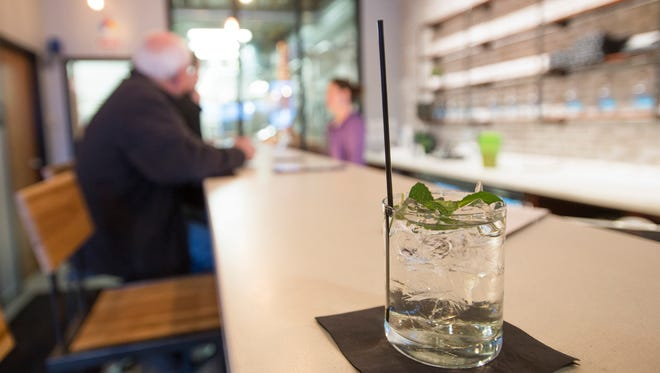 A mint julep awaits a customer as Elevation 5003 Distillery hosts it's grand opening at 2601 Lemay Ave. Thursday, February 4, 2016. The distillery has started production of vodka and plans to supply customers with gin and corn whiskey in the near future.
