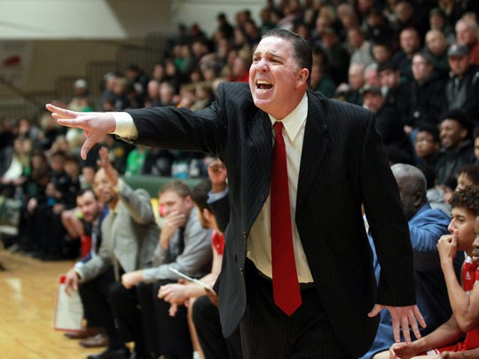 Jeffersonville High School basketball coach Joe Luce reacts to his teams play against Floyd  Central High School's  during the first half of play at Floyd Central High School in Floyd Knobs, Indiana.       Jan. 16,  2018.
