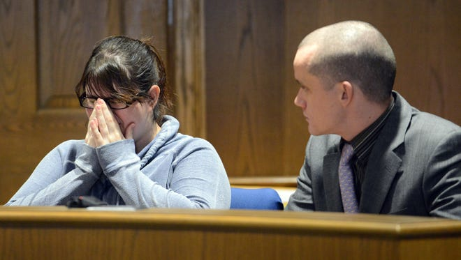 Dawn Tooill tries to fight back tears before speaking Tuesday during her change of plea and sentencing hearing in Fairfield County Common Pleas Court. Tooill was pleaded guilty to two counts of endangering children for twice breaking the leg of her 6-week-old son in 2014. Seated next to Tooill is her attorney Jacob Ort.