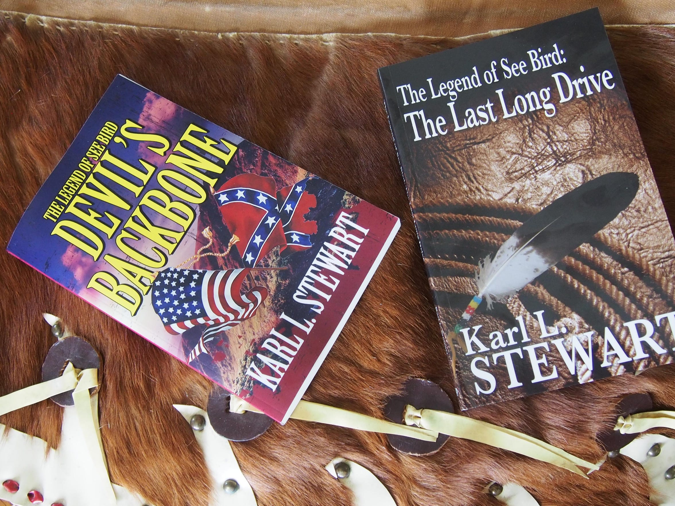 Karl Stewart's two books lay across a pair of adult