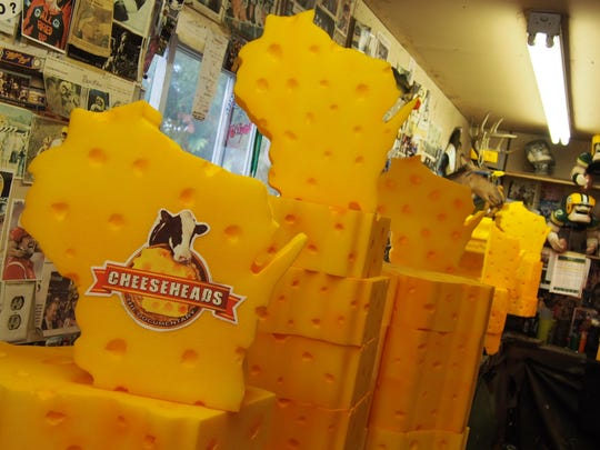 In honor of the release tour, John Mitchell commissioned a set of Wisconsin-shaped cheesehead hats from Jeff Kahlow, the foam artist of Big Guy Hats in Fond du Lac.