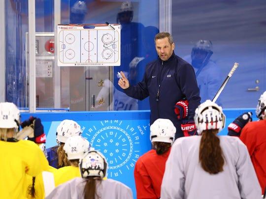 USA head coach Robb Stauber speaks with the USA women's