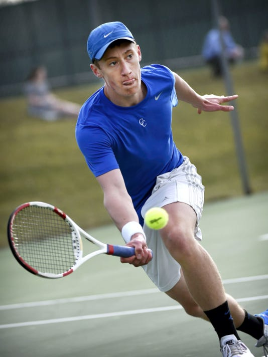 Cedar Crest's Colin Muraika lunges for a forehand volley during his 6-4, 6-3 loss to Hempfield's Derek Hagino at No. 1 singles on Monday. Hempfield also won the team match, by a 6-1 score.