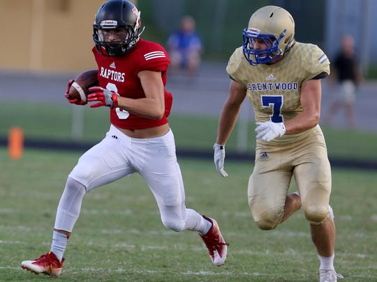 John Rall of Ravenwood runs the ball as Brentwood's