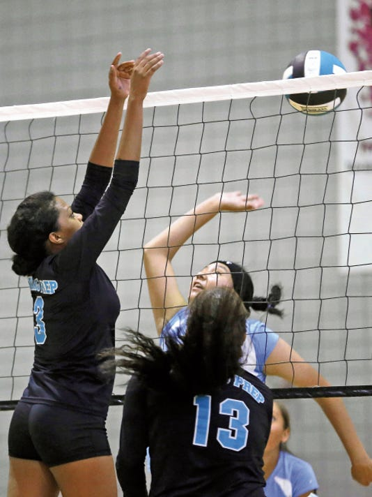 Navajo Prep's Jasmine Coleman, left, and Harlei Hacessa defend the net during their match against Dulce Wednesday at the Eagles Nest in Farmington.