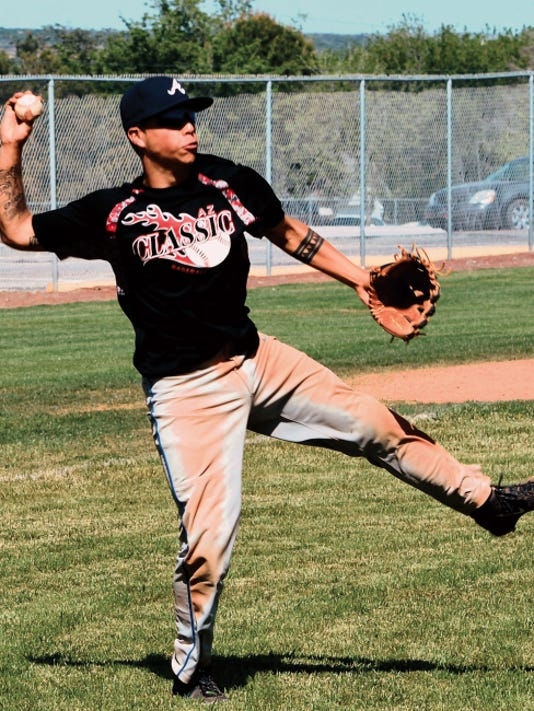 Matt Hollinshead — Current-Argus Cavemen junior third baseman Seth Olguin throws to first base for a quick put-out during Wednesday's practice. Carlsbad will play in a doubleheader at 4 p.m. today at Clovis.