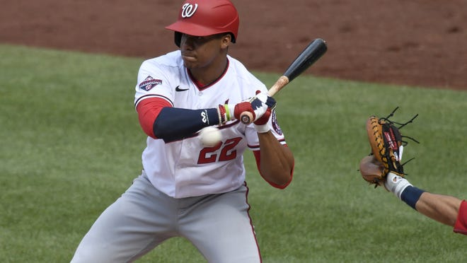 Washington's Juan Soto will miss the start of the season after testing postive for COVID-19.