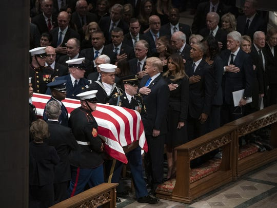 Stories are untrue that Trump didn't have his hand over his heart as the casket of former President George H.W. Bush was carried past.