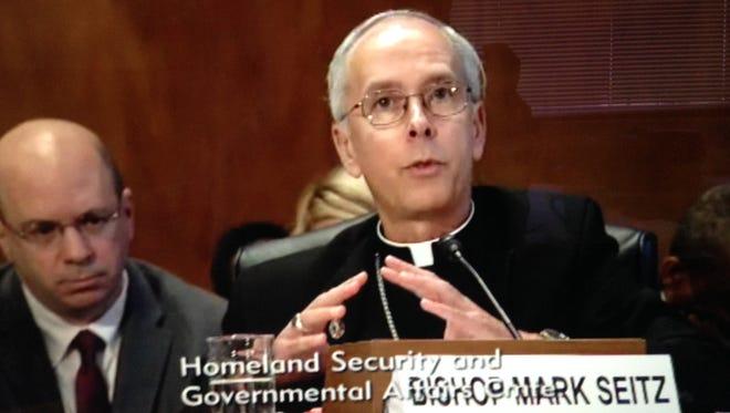 Bishop Mark Seitz testifies before a U.S. Senate committee Wednesday in Washington, D.C.