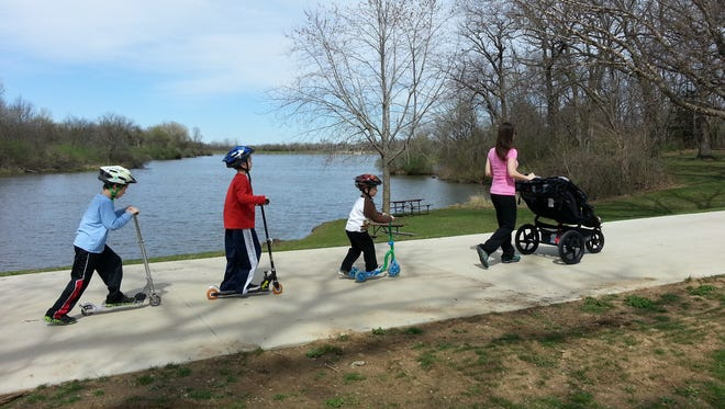 A family traveling around the recreational path at Easter Lake.