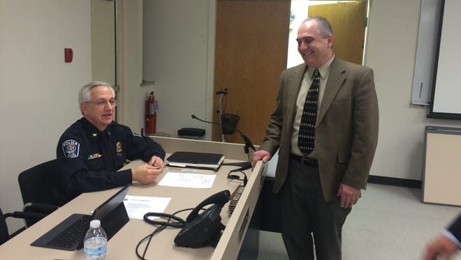 City of Brighton Utilities Director Tim Krugh, right, and Brighton Police Chief Tom Wightman share a light moment before Thursday's council meeting.