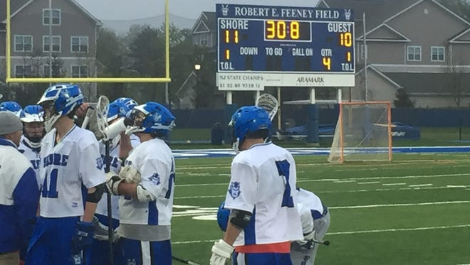 The Shore Regional boys lacrosse team talks over a play during a timeout with 30.8 seconds left in regulation