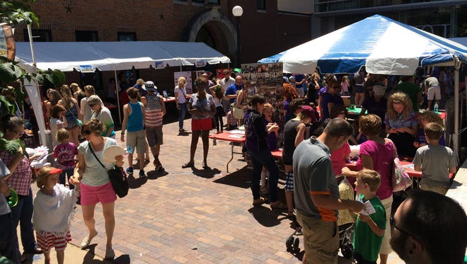 People gather on the pedestrian mall in downtown Iowa City on Sunday for the 33rd annual Iowa Arts Festival.