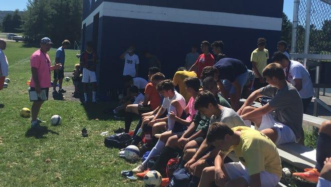 John Jay High School boys soccer coach Rob Seipp talks with his players after practice Tuesday.