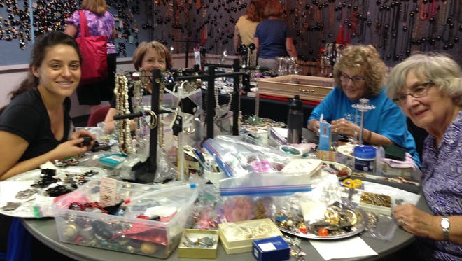 Angela Doa (from left), Lori Doa, Jackie DaPra, and Charlene Haesler carefully sort and price jewelry donated for the rummage sale at the First United Methodist Church. It will be displayed nicely for customers at the sale.
