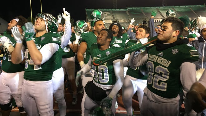 Eastern Michigan football players celebrate the 26-21 win over Central Michigan on Tuesday, Nov. 22, 2016 at Rynearson Stadium in Ypsilanti.