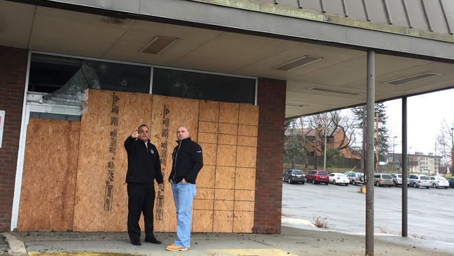Binghamton Mayor Richard David, left, and state Sen. Fred Akshar, right, outside the condemned Big Lots Plaza, which will be demolished courtesy of a $500K state grant.