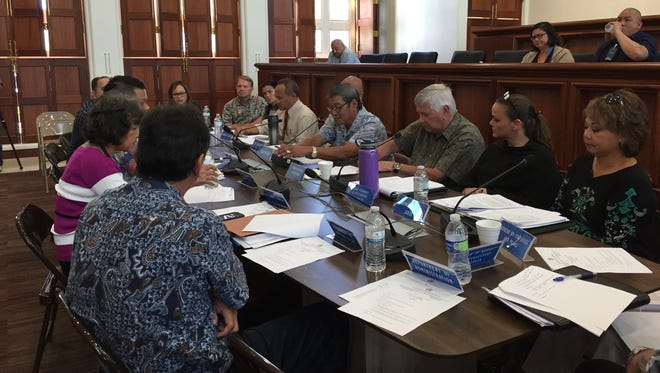 Members of the Guam Tax Commission meet at the Guam Congress Building on Sept. 5.