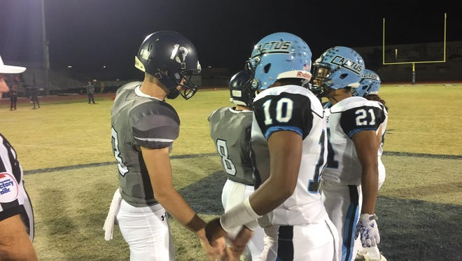 Cactus and Higley meet at midfield for a coin toss before the match in Gilbert, AZ.
