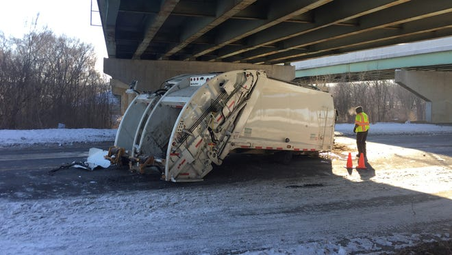 Workers clean up the wreckage Thursday, Jan. 4, after a truck struck the Sagamore Parkway overpass over North Ninth Street Road.