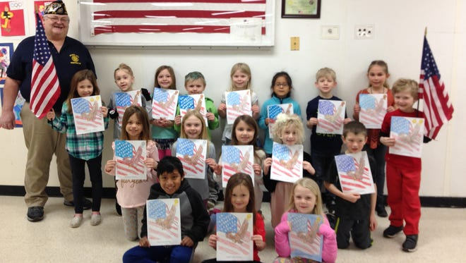 The Forestville American Legion announced the winners of its annual coloring contest at Southern Door Elementary School Shown with their pages are, front row from left, David Delgado, Ali Griep, Caroline Milewicz; middle row, Brooklyn Cmeyla, Leesel Aleson, Jaeden Lapacek, Leah Nooyen, Ashton Bouche; and back row, Legion member Allen Beuchner, Camden Soukup, Josie Knapp, Calla Rose DeFere, Chase Massart, Lilly Vandertie, Marilyn Garcia-Hernandez, Aydrin Massey-Weckler, Malaina Veeser, and Sam Lien.