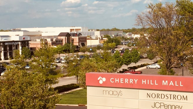 A Merchantvile man is accused of groping and robbing a shopper outside  Cherry Hill Mall.