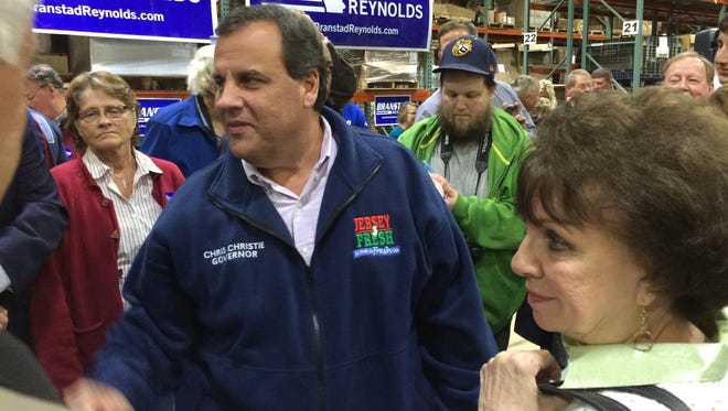 New Jersey Gov. Chris Christie  shakes hands during a stop in Burlington, Iowa.
