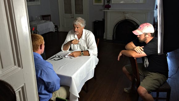 """Interview, 7 p.m."" director Rob Waters (right) with actor Thomas Cooksey, in blue, and Matt Haley on the film's set in June. The 10-minute short film will premiere Friday at 7 p.m. at the Delaware Art Museum to open the 7th annual Festival of Shorts."