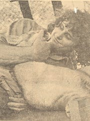 Les Whitt is shown wrestling with a cougar in 1974.
