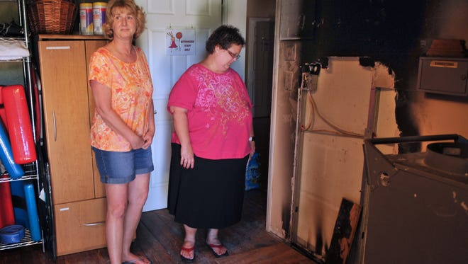 Morgan's Place Founder Kristen Malfara and Tonya Bloodgood, whose title is Director of Fun, standing in the kitchen near the source of the fire that started last week at Morgan's Place in Melbourne, which caused extensive damage in the kitchen and smoke damage throughout the building.