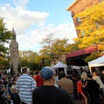 People jam into Corning's Centerway Square for a performance during the 2013 Harvest Music Festival.