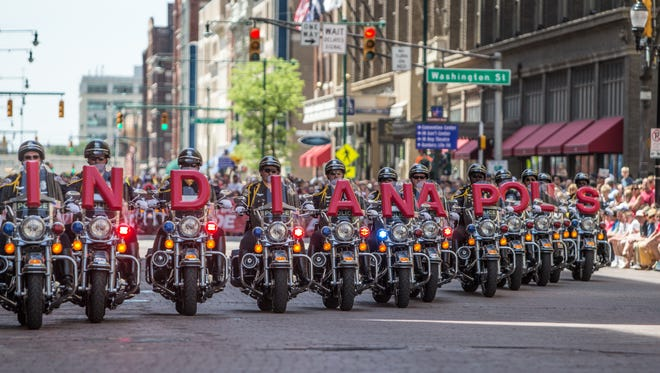 Saturday May 24th, 2014, Indianapolis Metropolitan Police Motorcycle Drill Team, performs during The IPL 500 Festival Parade.