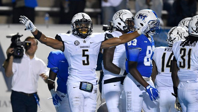 Vanderbilt safety LaDarius Wiley (5) celebrates after an MTSU play was ruled not to be a touchdown during the second half  Sept. 2, 2017, at Floyd Stadium.