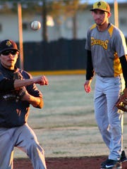 Nico Reyes, left, turns a double play during practice. Alamogordo opens up the season on Feb. 23 at Centennial.